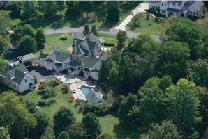 Sprawling estate stretches over 2.07 acres. The property includes not just a main house, but also pool house and carriage house.