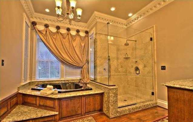 Amazing master suite features a large jacuzzi tub and separate shower.