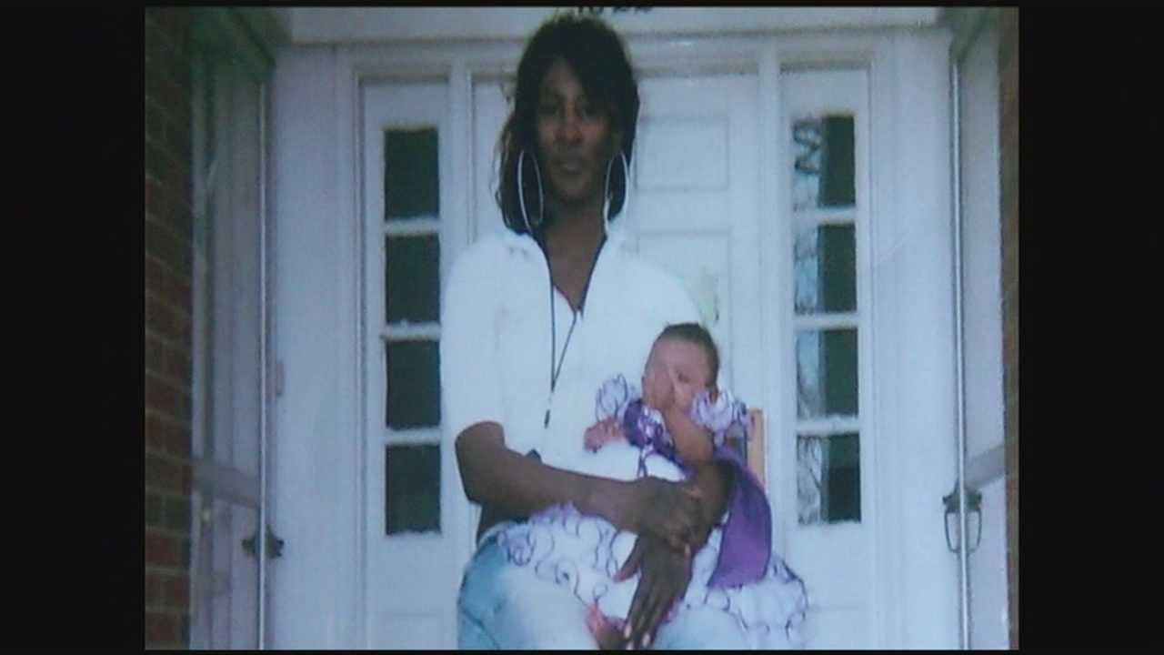 A mother of three was fatally shot in front of her home.
