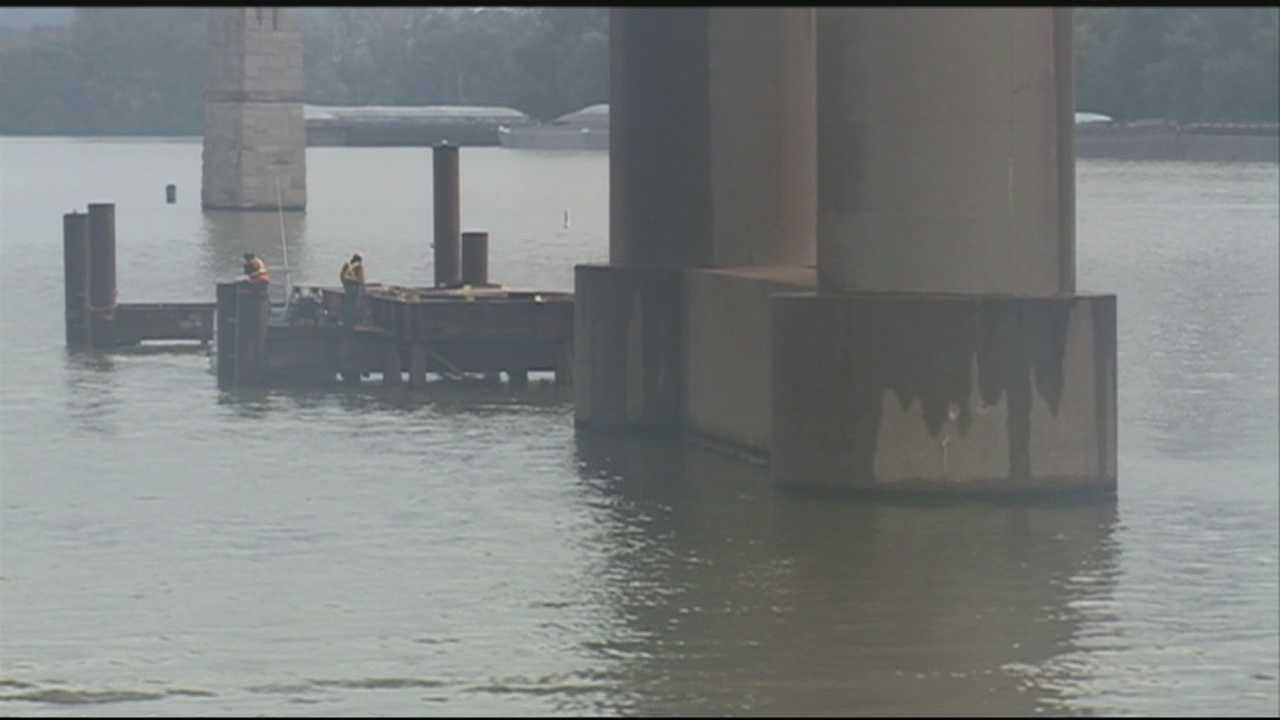 Signs of progress are visible in the Ohio River for the new downtown bridge.