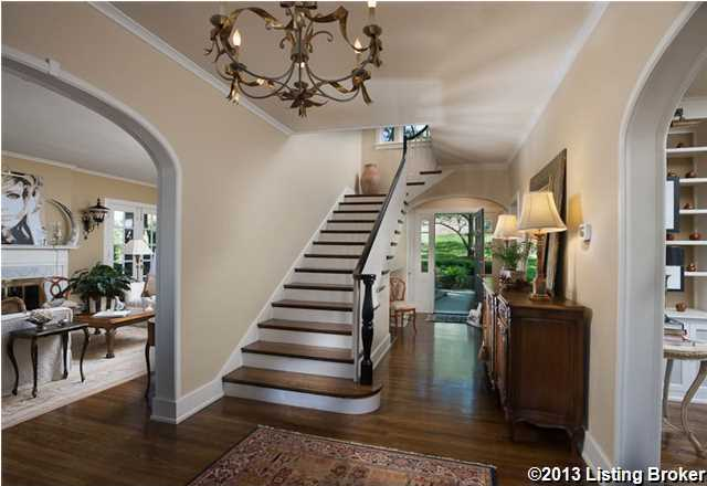 The wide entry foyer sets the tone for the home's sophisticated interior restorations, with a meticulously restored staircase and banister.
