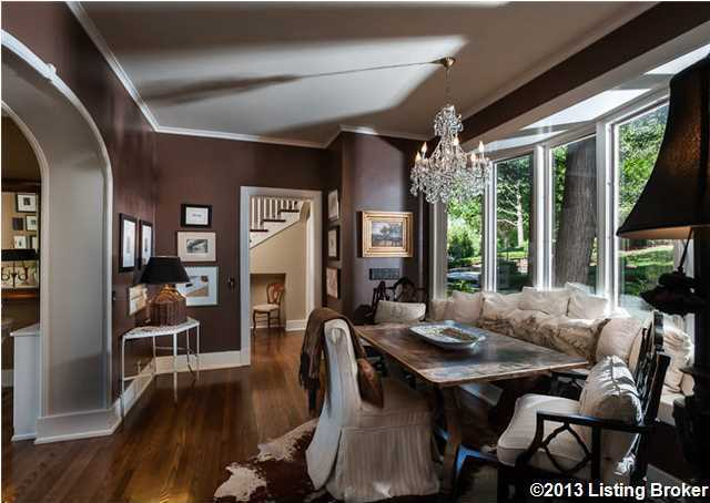 The cozy and fabulous dining room features a spectacular picture window, which frames the rear grounds.