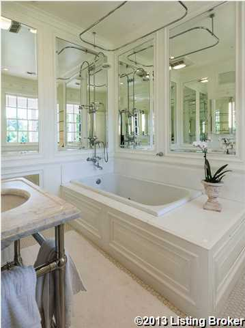 The master bathroom renovations include: heated tile floors, marble sink, custom fixtures, imported extras, and spacial perfection.
