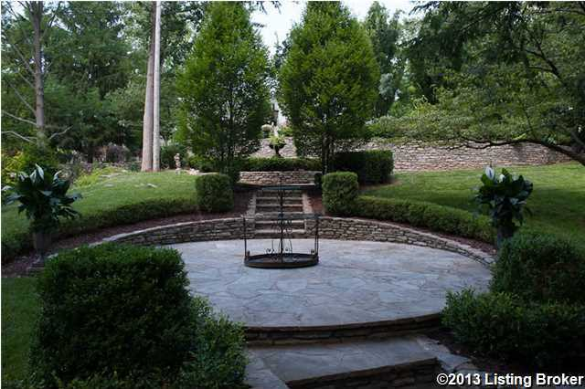 Several stone terraces are on the property, surrounded by meticulously landscaped lawns.