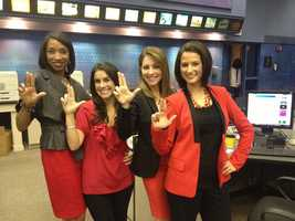 Ann Bowdan, Marissa Alter, Christina Mora and Erica Coghill wear red ahead of the Louisville Cardinals' appearance in the 2013 NCAA basketball national championship game