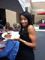 Showing off some of her favorite foods at the station BBQ picnic