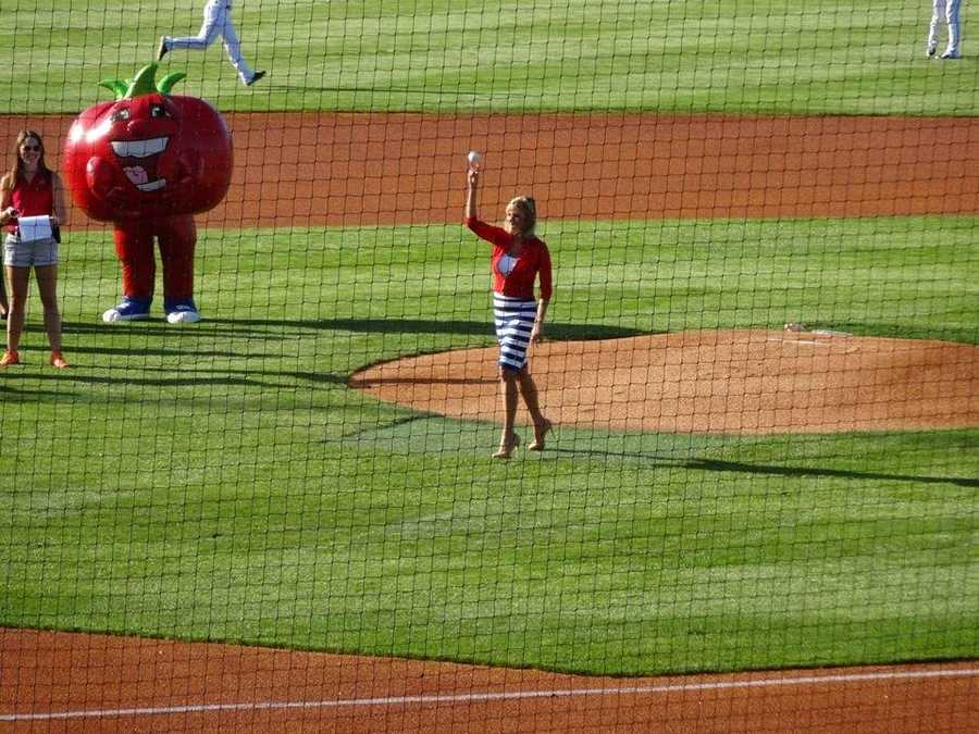 Vicki throws out the first pitch at a Louisville Bats game for WLKY Night at Slugger Field in summer 2013.