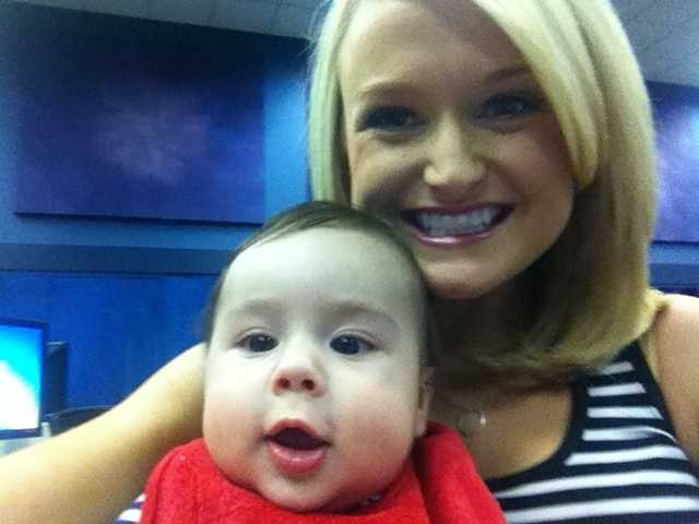 Weekend morning anchor Lexy Scheen borrows a baby for her selfie