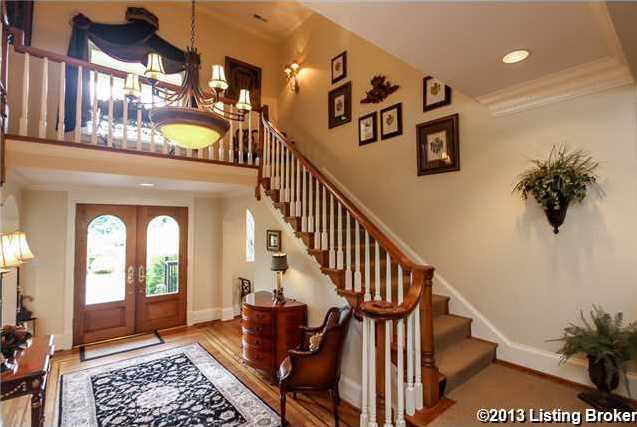 The exquisite French Manor Estate home welcomes you with handsome walnut double entry doors that open into the two-story hall with a beautiful turned staircase that winds up and around, creating a balcony over the front entry.