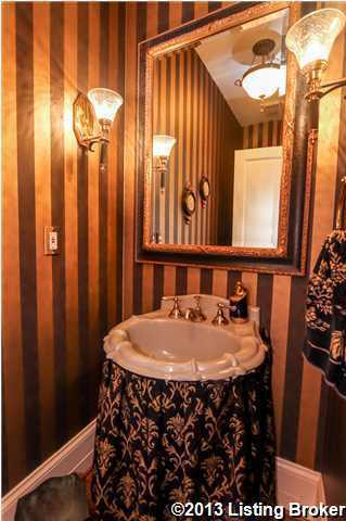Guests are welcomed to the use this glamorous half-bathroom.