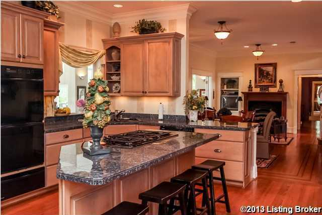 Take a look at this huge center island breakfast bar w/ 5 burner gas cooktop, 2 dishwashers and a butler's pantry.