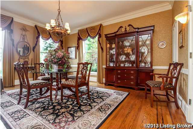 The spacious dining room has 3 large windows, crown molding and hardwood floor.