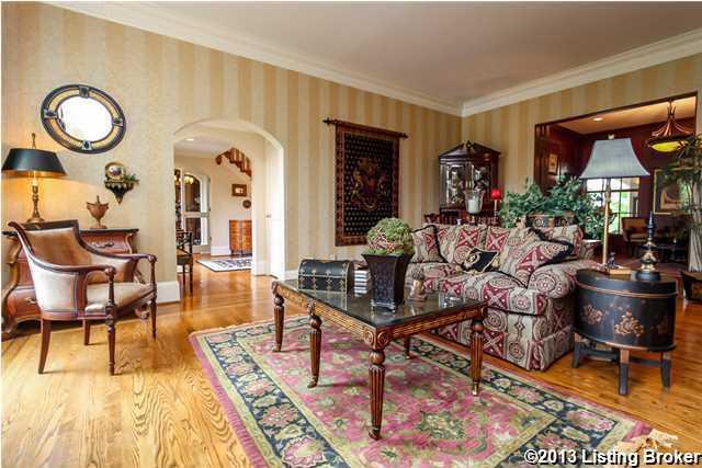 The Living Room (21x15) has large windows, inlaid hardwood floors and deep crown molding.