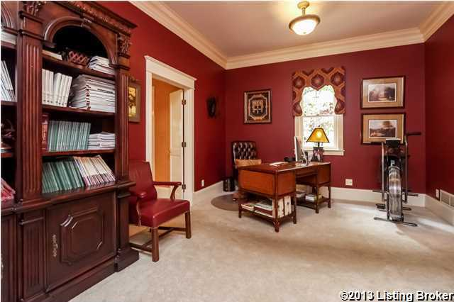 The living room opens to the library with gorgeous raised-panel walls, built-in bookcases and fireplace.
