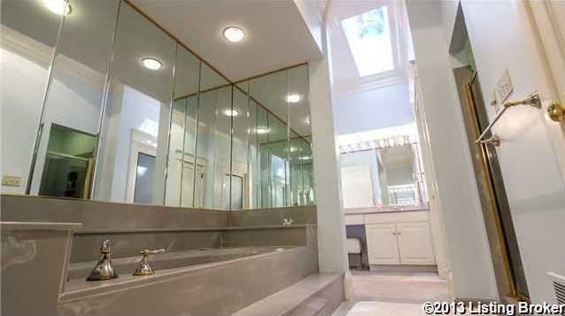 The master bath with double vanities, skylight, walk-in closet and whirlpool tub.