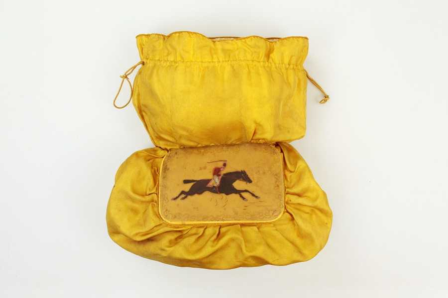 """This silk purse from the 1891 Kentucky Derby, presented to winning owner Kinzea Stone, held the money, or """"purse"""", for winning the race."""