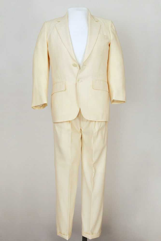 This white suit is believed to have been worn by Bill Shoemaker for his famous American Express ad campaign with basketball star Wilt Chamberlain.