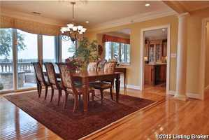 The dining room looks over the Ohio River and provides access to the private balcony.