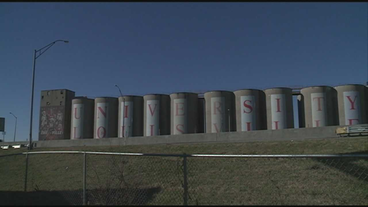 The silos along Interstate 65 near the University of Louisville will be demolished as the school looks to expand.