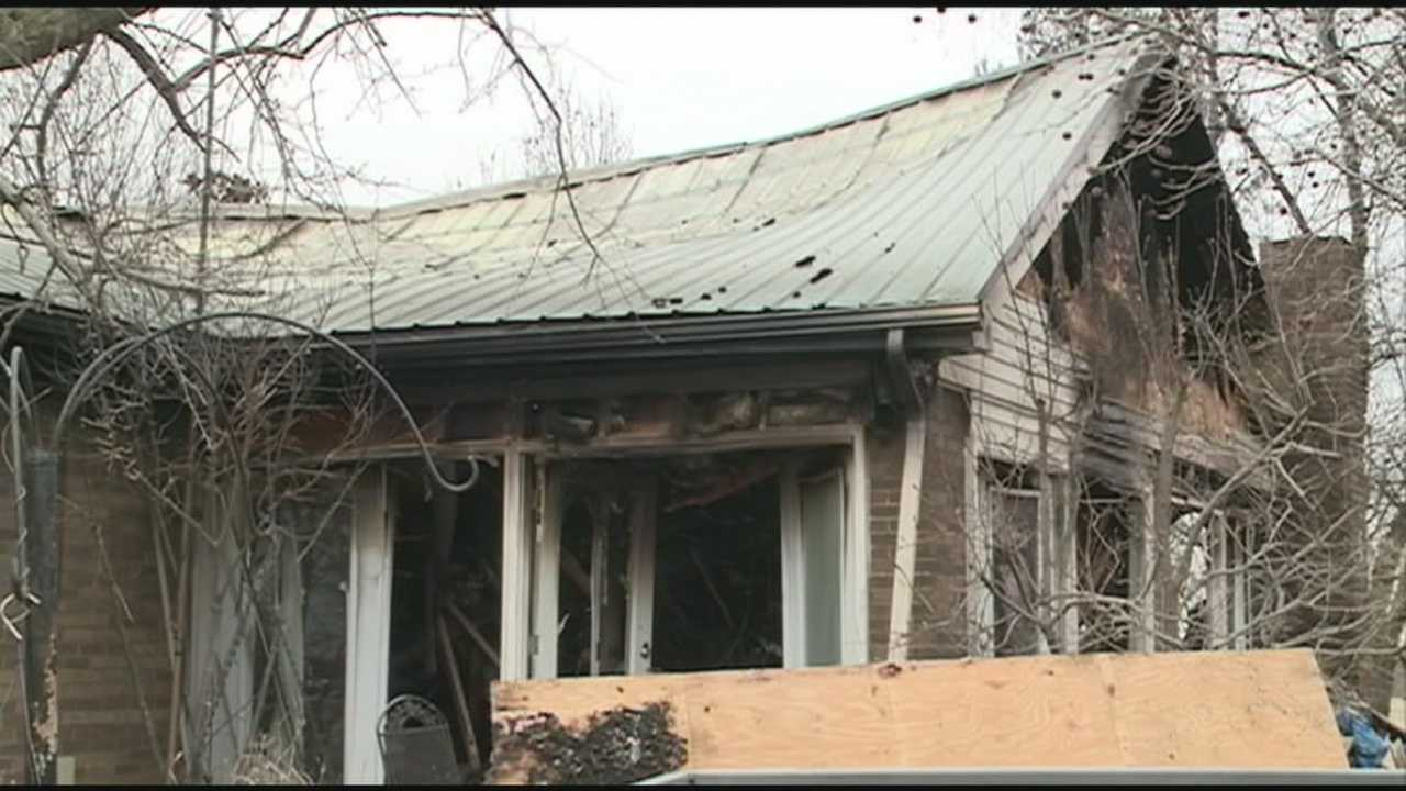 A couple's home and business are destroyed by fire Thursday in Bagdad.