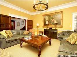 Beautiful family room features crown moldings and fireplace.