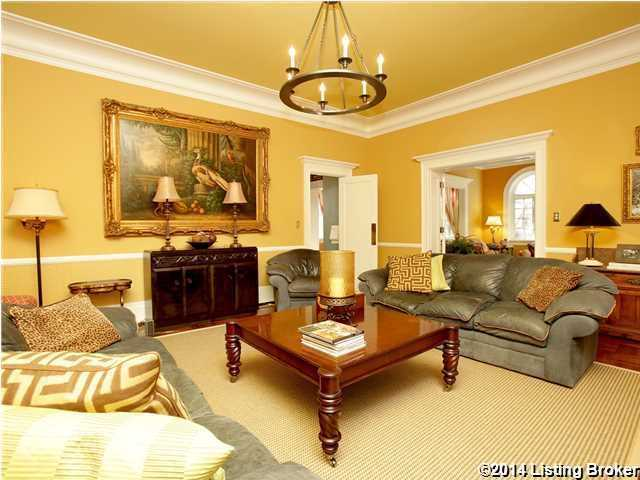 It features a beautiful antique art piece above the fireplace as well.