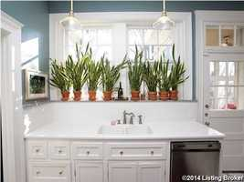 Farm sink and modern counter-tops.