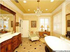 Master bathroom features a free-standing spa tub.