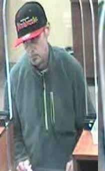 The robber is a white man, about 40-50 years old, 5 feet 9 inches tall and weighing about 160 pounds.