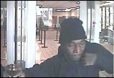 That robber is a black man, 30-40 years old, 5 feet 10 inches tall and weighing about 170 pounds.