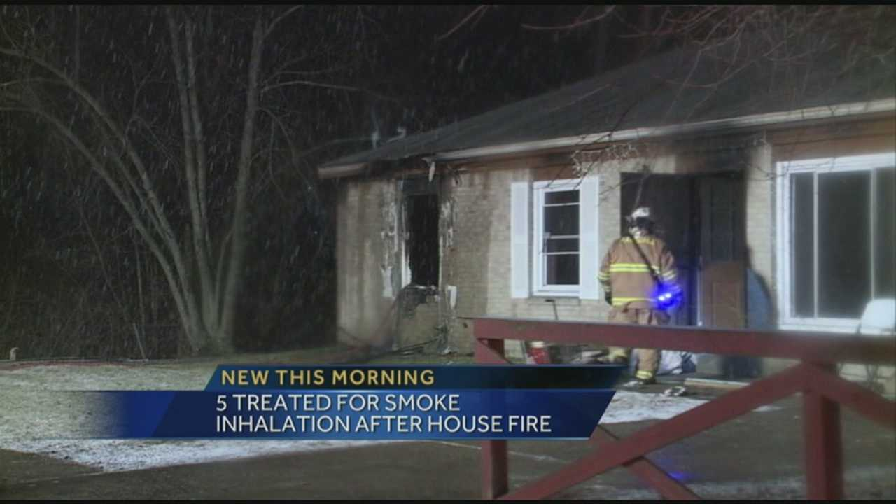 Five people were transported to area hospitals after fire broke out at a home on Tallow Lane.