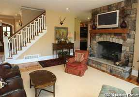 A second fireplace lies below the TV in the family room.