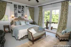 Master bedroom features a private balcony.