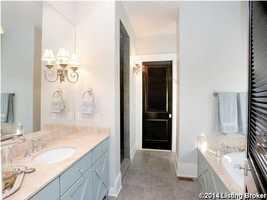 Simply tasteful en suite master bathroom.