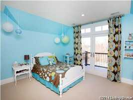Playful children's room is one of seven bedrooms in the home.