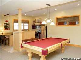 Amenties such as the pool table make this room an excellent candidate for a man cave.