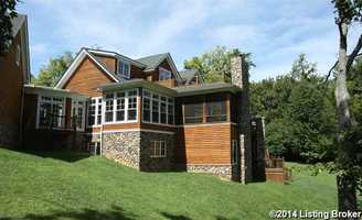 This side view showcases the home's expansive deck on top of the sunroom and covered patio.