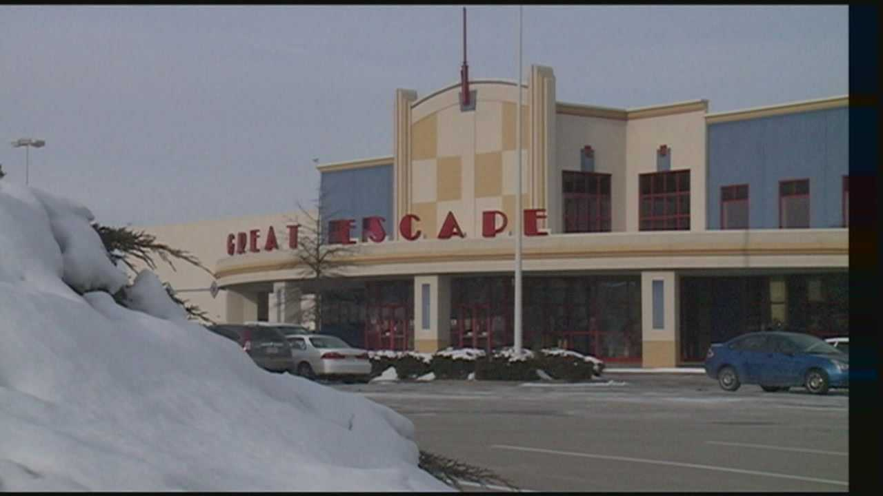 Police in New Albany say a man who tried to rob an area movie theater claimed to have a bomb.