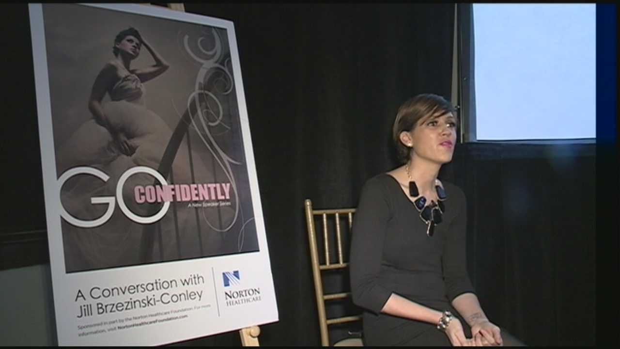 A woman dying of breast cancer speaks at an event to benefit cancer patients.