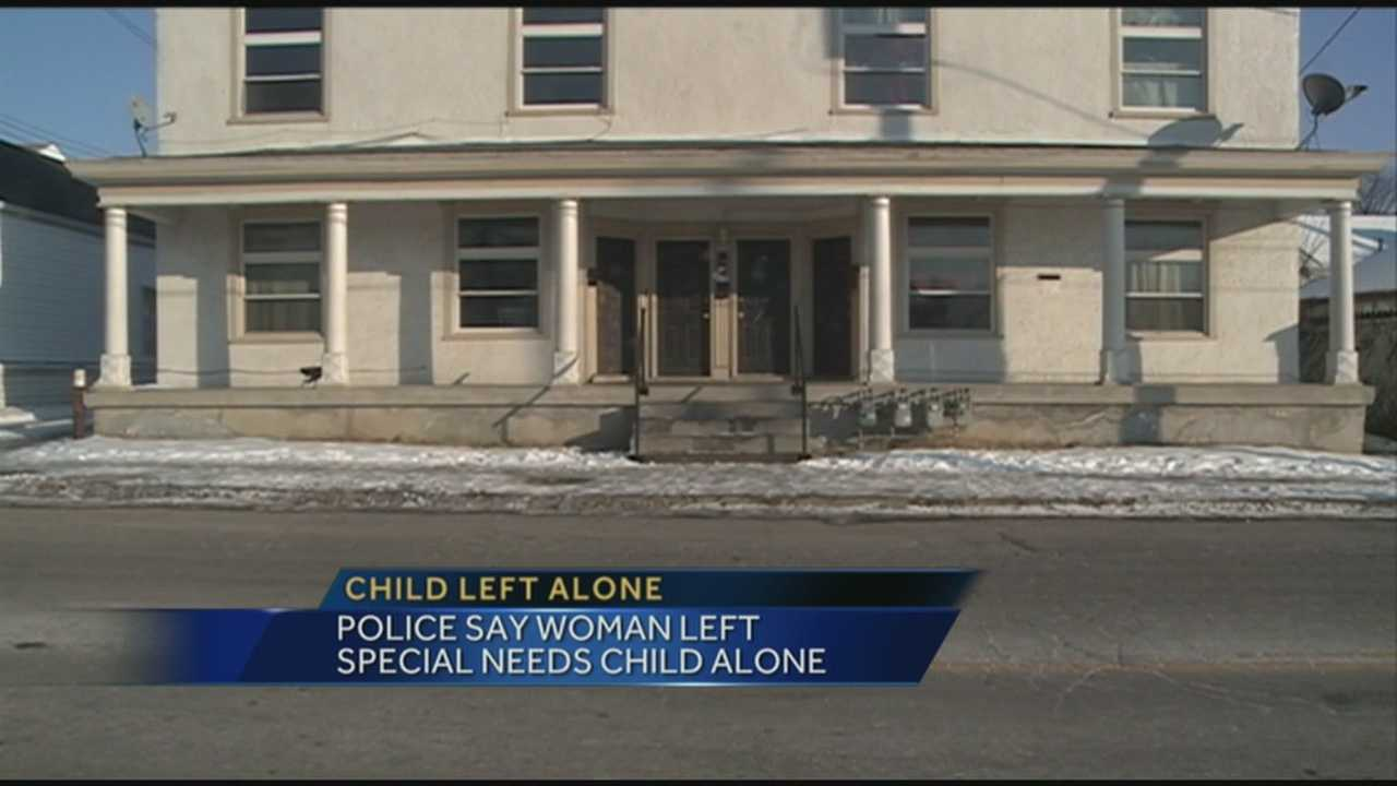 A woman is charged after police said she left a special needs child home alone.