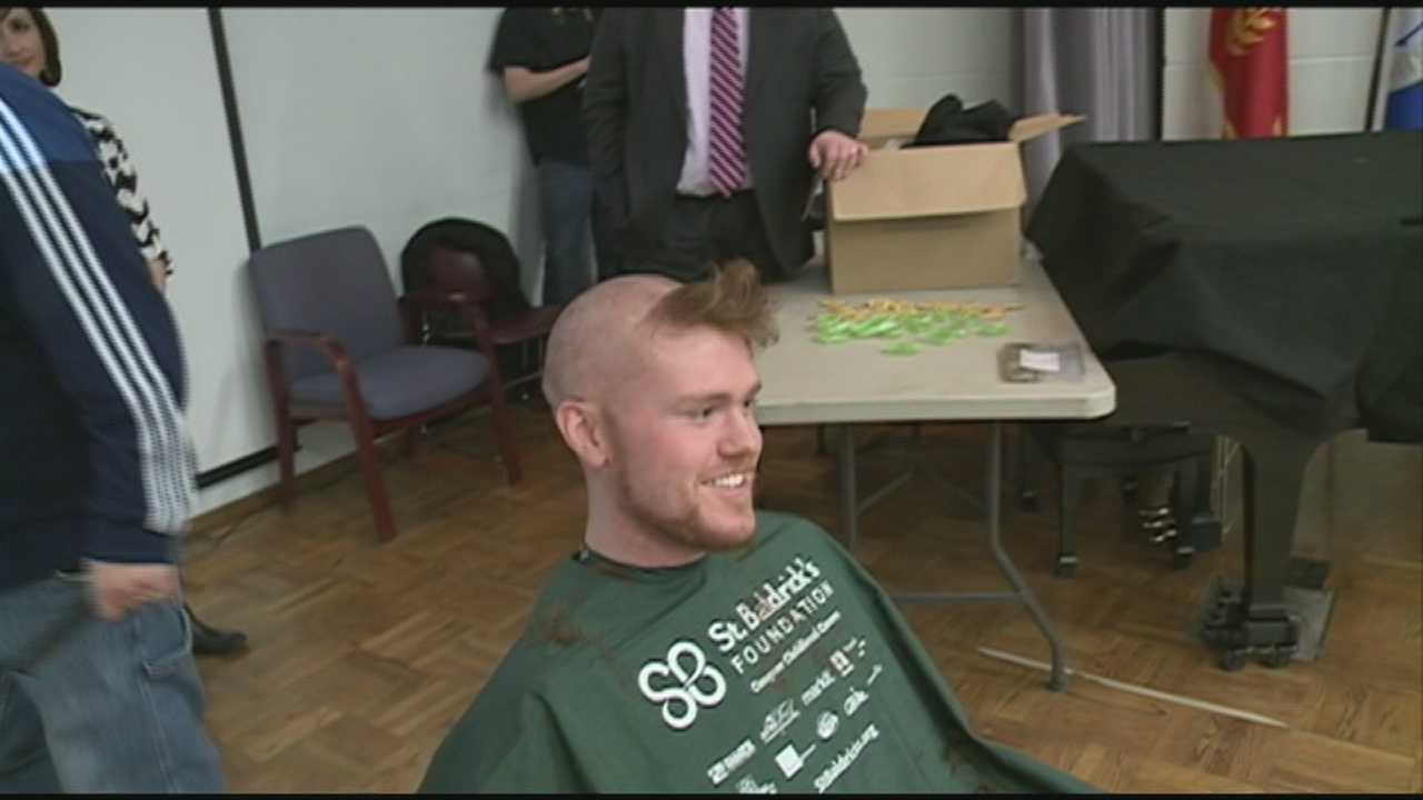 A group of students at the University of Louisville shave their heads for childhood cancer research.