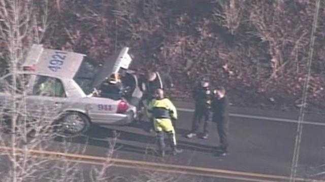 car in creek police.jpg