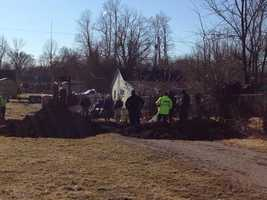 Excavation underway in Elizabethtown. Police are following a deathbed confessional and believe there might be a body there.