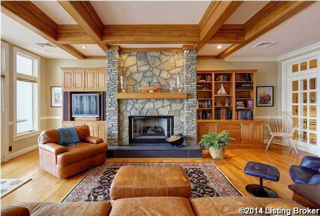 Fireplace warms this comfy family room.