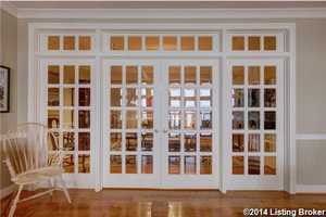 Formal dining room is separated by french doors.