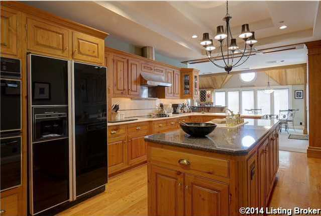 Wide open kitchen features a large cooking island, overlooking the river as well.