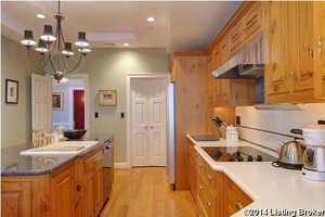 Large farm sink and gas stove in the kitchen.
