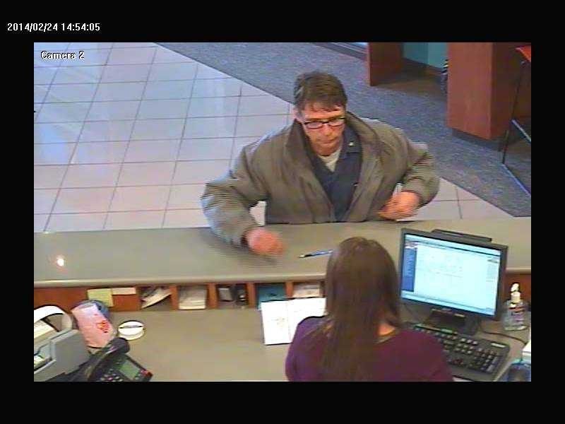 A police officer was involved in a crash Monday afternoon after a bank robbery at Your Community Bank on East 10th Street in Jeffersonville. This is the suspect involved in the robbery from bank surveillance.