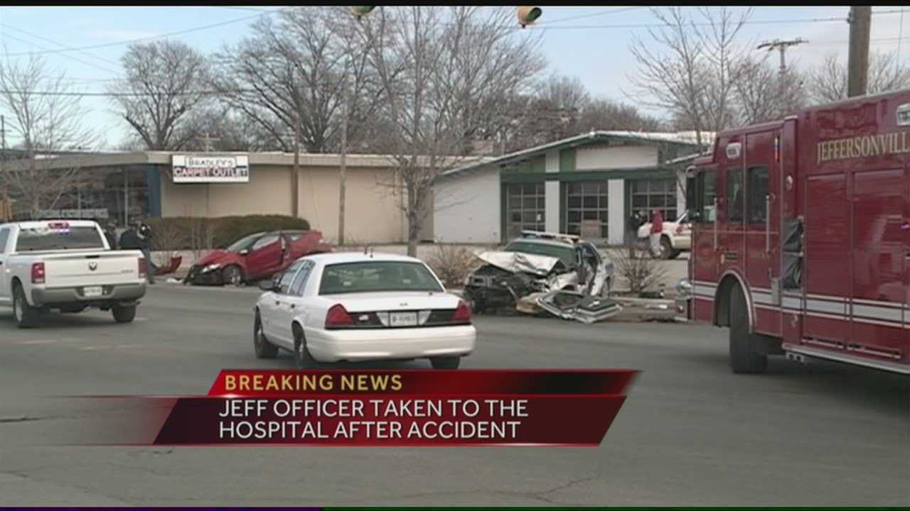 An officer responding to a robbery in progress at Your Community Bank in Jeffersonville was involved in a crash that sent him and another driver to the hospital.