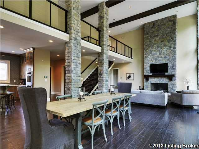Sunlight bursts into the exquisite living/ dining area through floor-to-ceiling windows.